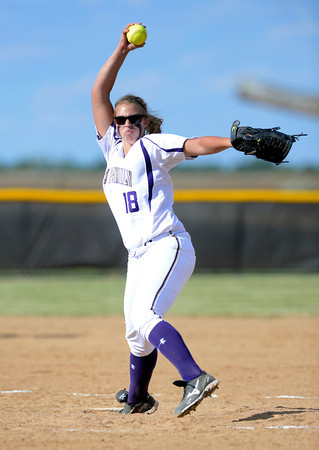 """Holy Family High School's Nicole Gardon fires the ball against Monarch High School during their softball game at Monarch High School on Tuesday September 4, 2012.<br /> For more photos go to  <a href=""""http://www.bocopreps.com"""">http://www.bocopreps.com</a><br /> Photo by Paul Aiken /"""