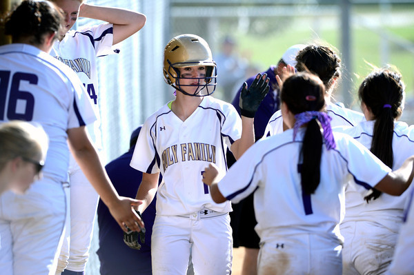 Holy Family  High School's Macy Cox (10) greets her teammates after scoring  during their softball game at Monarch High School on Tuesday September 4, 2012.<br /> PHoto by Paul Aiken / The Camera / Sept 4, 2012