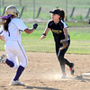 "Monarch High School's  Jessica Rainone waits for a throw as (18) Holy Family  High School's Haley Draudt (1) slides in safely to second base during their softball game at Monarch High School on Tuesday September 4, 2012.<br /> For more photos go to  <a href=""http://www.bocopreps.com"">http://www.bocopreps.com</a><br /> Photo by Paul Aiken /"