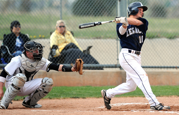 """Legacy High School's  Dillon Bollig (10) hits a solo home run against Monarch High School during their game Tuesday afternoon at Monarch High School April 17, 2012.<br /> For more photos of the game go to  <a href=""""http://www.bocopreps.com"""">http://www.bocopreps.com</a><br /> Photo by Paul Aiken   /  The Camera"""