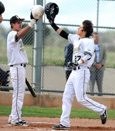 "Monarch High School's Logan Soole (27) is greeted by teammate Joe Stork after he hit a home run during their game against Legacy Tuesday afternoon at Monarch High School April 17, 2012.<br /> For more photos of the game go to  <a href=""http://www.bocopreps.com"">http://www.bocopreps.com</a><br /> Photo by Paul Aiken   /  The Camera"