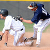 "Legacy High School's Dillon Bollig (10) puts the tag on Monarch High School's Brian Wood (6) during their game Tuesday afternoon at Monarch High School April 17, 2012. Wood was stretching an infield error and got into base safely. <br /> For more photos of the game go to  <a href=""http://www.bocopreps.com"">http://www.bocopreps.com</a><br /> Photo by Paul Aiken   /  The Camera"