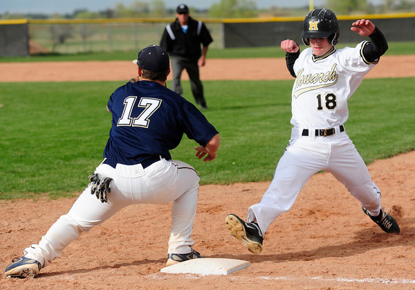"Legacy High School's Jakob Bublitz (17) waits for the pickoff throw as Monarch High School's Geoff Clary (18) leaps back to first during their game Tuesday afternoon at Monarch High School April 17, 2012.<br /> For more photos of the game go to  <a href=""http://www.bocopreps.com"">http://www.bocopreps.com</a><br /> Photo by Paul Aiken   /  The Camera"
