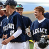 "Legacy High School's  Dillon Bollig (10) is greeted by teammates after he hit a solo home run against Monarch High School during their game Tuesday afternoon at Monarch High School April 17, 2012.<br /> For more photos of the game go to  <a href=""http://www.bocopreps.com"">http://www.bocopreps.com</a><br /> Photo by Paul Aiken   /  The Camera"