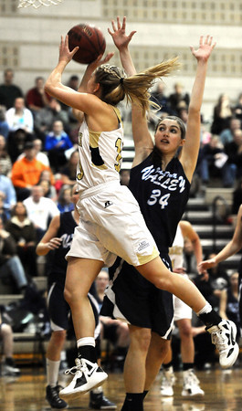 """Monarch High School's Ashton Davis (13) drives to the basket against Ralston Valley Mustang's Elizabeth Hornung (34) during their game at Monarch High School on Wednesday February 29, 2012.<br /> For more photos from the game go to  <a href=""""http://www.dailycamera.com"""">http://www.dailycamera.com</a><br /> Photo by Paul Aiken / The Camera"""