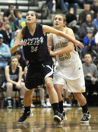 "Monarch High School's Bridget Anthony (23), right, battles with Ralston Valley Mustang's Hannah McGinley (34) under the basket during their game at Monarch High School on Wednesday February 29, 2012.<br /> For more photos from the game go to  <a href=""http://www.dailycamera.com"">http://www.dailycamera.com</a><br /> Photo by Paul Aiken / The Camera"