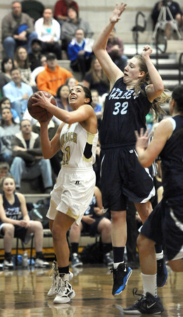 """Monarch High School's Rebecca Richmond (11) drives to the hoop against Ralston Valley Mustang's Sierra Galbreath (32) during their game at Monarch High School on Wednesday February 29, 2012.<br /> For more photos from the game go to  <a href=""""http://www.dailycamera.com"""">http://www.dailycamera.com</a><br /> Photo by Paul Aiken / The Camera"""