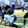 Monarch High's Gus Sawicki (42) hits the tackler Standley Lake's Michael Casados (13) after Sawicki caught a pass during their game  on Friday October 7, 2011 at Centaurus High School in Lafayette. <br /> Photo by Paul Aiken / October 7, 2001