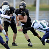 Monarch High's Jared Meschke (36) runs between Standley Lake's  Trey Jarvis (31)and Nate Carlson (17) during their game on Friday October 7, 2011 at Centaurus High School in Lafayette. <br /> Photo by Paul Aiken / October 7, 2001