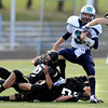 Monarch High's from left to right Brian Wood (19) Trevor Carver (21) and Travis Gamblin (30) gang tackle Standley Lake's Matt Fujinami (3)  during their game  on Friday October 7, 2011 at Centaurus High School in Lafayette. <br /> Photo by Paul Aiken / October 7, 2001