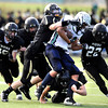 Monarch High's Wes Moon (18) Colin Hart (24) and RJ Johnson (22) swarm over Standley Lake's Tanner Shoemate (88) on a pass play   during their game  on Friday October 7, 2011 at Centaurus High School in Lafayette. <br /> Photo by Paul Aiken / October 7, 2001
