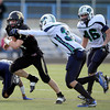 Monarch High's Ethan Marks (34) runs away from Standley Lake's Trey Jarvis (31) during their game on Friday October 7, 2011 at Centaurus High School in Lafayette. <br /> Photo by Paul Aiken / October 7, 2001
