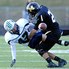 Monarch High's Trevor Carver (21) separates Standley Lake's Nick Bongiardina (47) from the ball during a pass play during their game  on Friday October 7, 2011 at Centaurus High School in Lafayette. <br /> Photo by Paul Aiken / October 7, 2001