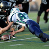 Monarch High's Travis Schlueter (64) and Standley Lake's Mitch Ernster (83) dive for the ball after Ernster fumbled on a reverse during their game on Friday October 7, 2011 at Centaurus High School in Lafayette. Monarch High recovered deep in their own side of the field. <br /> Photo by Paul Aiken / October 7, 2001