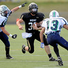 Monarch High's Jared Meschke (36) runs between Standley Lake's  Mitch Ernster (83)and Michael Casados (13) during their game on Friday October 7, 2011 at Centaurus High School in Lafayette. <br /> Photo by Paul Aiken / October 7, 2001