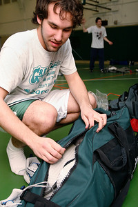 Physics junior Ryan Majewski packs up his equipment at the end of fencing practice. The club provides equipment and instruction for beginners to encourage newcomers to the sport.