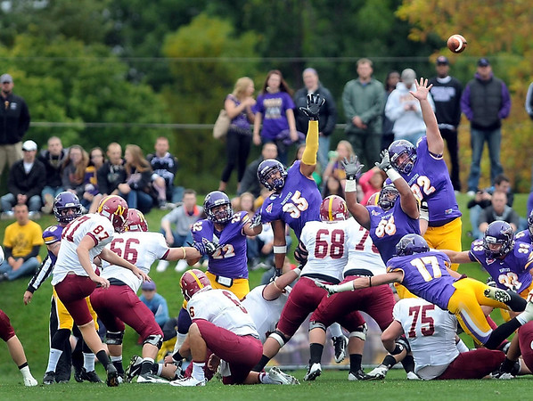 Pat Christman <br /> Minnesota State players leap in an attempt to block a field goal attempt by Northern State's Nathan Shaw during the first half Saturday. They didn't get the block, but Shaw missed the kick.