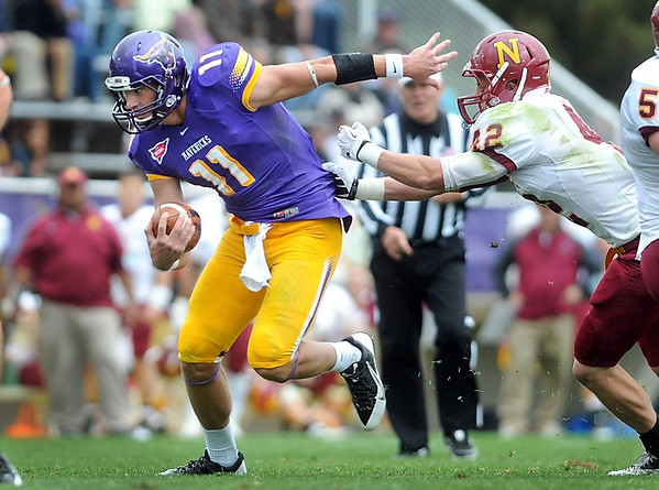 Pat Christman <br /> Minnesota State quarterback Jon Wolf evades Northern State's Mike Tuch during the first half Saturday.