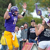 Pat Christman <br /> Minnesota State University quarterback Jon Wolf celebrates his second touchdown run of the game with fans during their game against Northern State Saturday at Blakeslee Stadium.