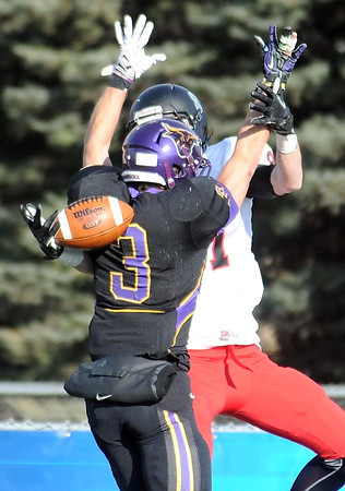Pat Christman<br /> The ball hits Minnesota State's Patrick Schmidt in the back as St. Cloud State's Matt Hentges tries to make the catch in the end zone during the first half Saturday. Schmidt was called for pass interference on the play.