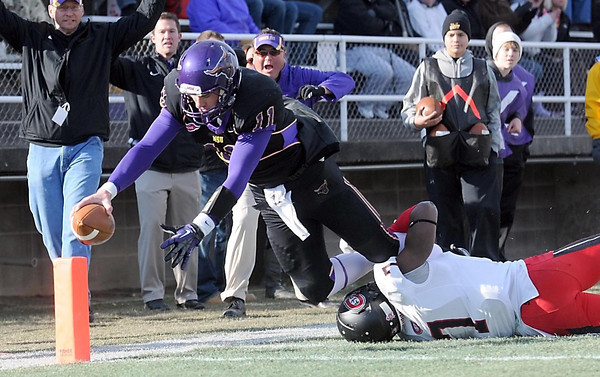 Pat Christman<br /> Minnesota State quarterback Jon Wolf dives into the end zone during the first half against St. Cloud State Saturday at Blakeslee Stadium.