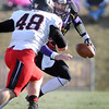 Pat Christman<br /> Quarterback Jon Wolf tries to get past St. Cloud State's Todd Bestgen during the first half Saturday at Blakeslee Stadium.