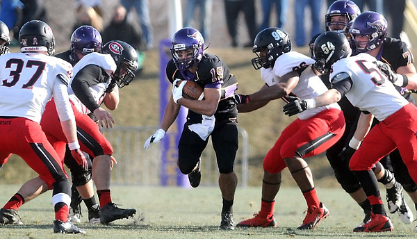 Pat Christman<br /> Minnesota State's Andy Pfeiffer finds a hole in the St. Cloud State defense during the first half Saturday.
