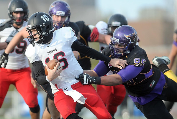 Pat Christman<br /> St. Cloud State quarterback Phillip Klaphake is pursued by Minnesota State's Josh Gordon during the second half Saturday.