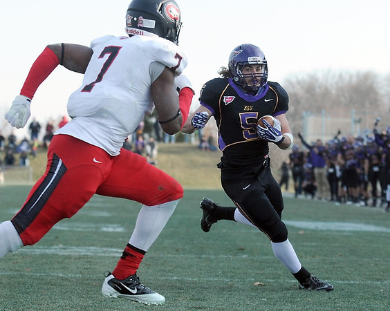 Pat Christman<br /> Minnesota State running back Connor Thomas beats St. Cloud State's Marvin Matthews to the end zone on a trick play during the second half Saturday.