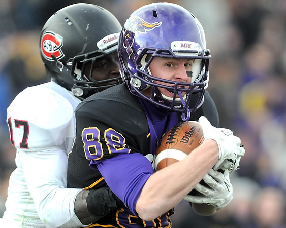 Pat Christman<br /> Minnesota State's Austin Rieder pulls in a pass for a touchdown in front of St. Cloud State's Brady Westart during the fourth quarter Saturday.