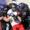 Pat Christman<br /> St. Cloud State's Chad Peterson is stopped during a first half kickoff return Saturday.