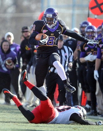 Pat Christman<br /> Minnesota State receiver Dennis Carter hurdles a St. Cloud State defender during the first half Saturday at Blakeslee Stadium.