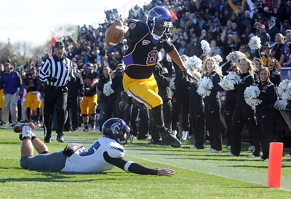 Pat Christman<br /> Minnesota State's Dennis Carter leaps over a Winona State defender and into the end zone Saturday.