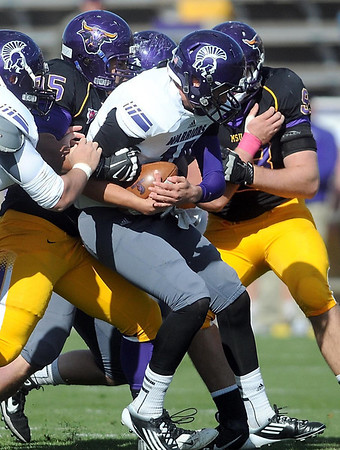 Pat Christman<br /> Minnesota State defensive linemen take down Winona State quarterback Jack Nelson during the first half Saturday at Blakeslee Stadium. The Mavericks' defense recorded 9 sacks in their 44-10 win, tying a school record.