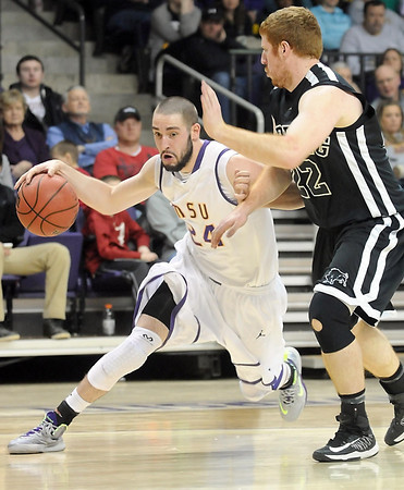 Minnesota State's Tanner Adler drives around Harding's John Hudson during the first half of the NCAA Division II Central Region tournament game Saturday at Bresnan Arena. Pat Christman