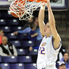Minnesota State's Zach Monaghan slam dunks the ball after a steal in the second half Saturday at Bresnan Arena. Pat Christman