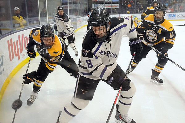 Pat Christman<br /> Minnesota State's Max Gaede (8) is pursued by Michigan Tech's Shane Hanna (22) and Tanner Kero (10) as he chases the puck along the boards during the second period Saturday at the Verizon Wireless Center.