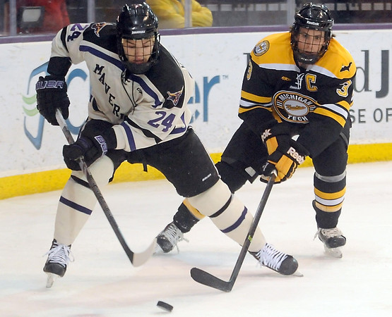 Pat Christman<br /> Minnesota State's Brett Knowles is chased behind the net by Michigan Tech's Bradley Stebner during the second period Saturday at the Verizon Wireless Center.