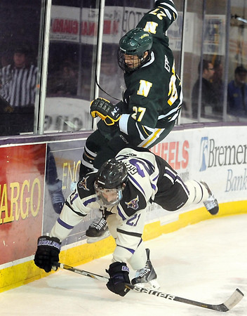 Northern Michigan's Wade Epp falls over Minnesota State's Chase Grant during the second period Saturday at the Verizon Wireless Center. Pat Christman