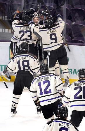 Minnesota State's Zach Stepan is mobbed by his teammates after scoring the game winning goal in overtime over Northern Michigan Saturday at the Verizon Wireless Center. Pat Christman