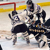 Minnesota State's Zach Stepan, back, scores the game winning goal in overtime to defeat Northern Michigan Saturday at the Verizon Wireless Center. Pat Christman