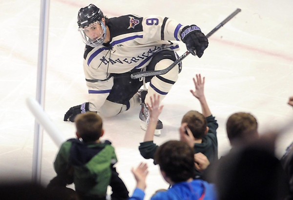 Minnesota State's Bryce Gervais celebrates a goal with a group of young fans near the glass during the third period Saturday at the Verizon Wireless Center. Pat Christman