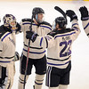 Minnesota State's Zach Stepan, center, celebrates with teammates after scoring the game winning goal in overtime over Northern Michigan Saturday at the Verizon Wireless Center. Pat Christman