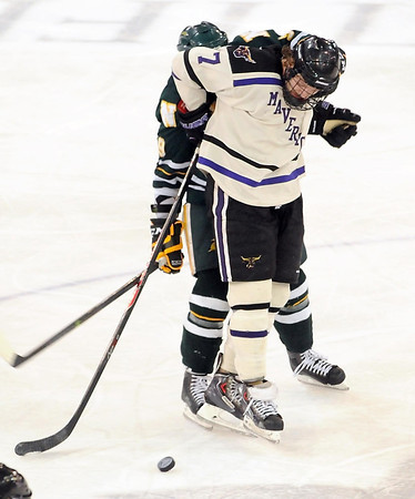 Minnesota State's Zach Palmquist gets tangled up with a Northern Michigan player during overtime Saturday at the Verizon Wireless Center. Pat Christman
