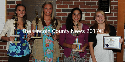 Medomak Valley softball awards were presented to Mallory Conary(Coaches Award, KVAC All Academic, KVAC 1st Team, and 10 letter club); Desiree Benner (KVAC 1st Team, MVP); Amanda Hendrickson (KVAC 1st Team, 3 letter plaque, and Most Improved); and Heidi Obuchon (3 letter plaque). Missing from the photo is Taylor Simmons (Most Improved).