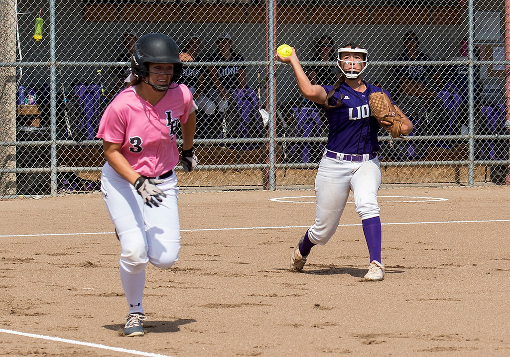 . Mountain View catcher Kaley Barker (14) throws out Loveland\'s Addi Woodard (3) at first base Saturday afternoon Sept. 17, 2016. The visiting Indians beat the Mountain Lions on their home field, 5-0. (Photo by Michael Brian/Loveland Reporter-Herald)
