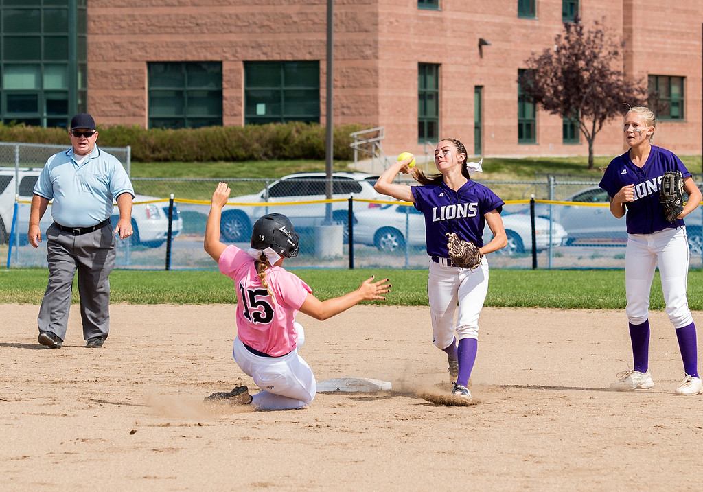 . Mountain View shortstop Izzy Griego (5) tries to turn a double play after getting the out at second base on Loveland\'s Gianna Tricarico (15) Saturday afternoon Sept. 17, 2016 as the visiting Indians beat the Mountain Lions, 5-0. (Photo by Michael Brian/Loveland Reporter-Herald)