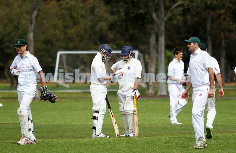 13-10-12. Maccabi Cricket v Powerhouse. Dean Weiner (left) and Mark Soffer chat between overs. Photo: Peter Haskin