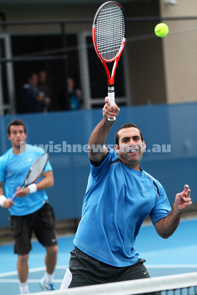 Maccabi Tennis pennent . 26-5-12. Asaf Nagar plays a winner at the net with partner Paul Arber looking on.  Photo: Peter Haskin