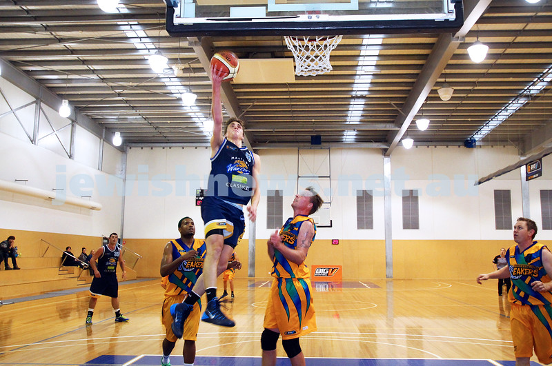 1-6-14. Basketball. Maccabi Warriors lost to Mornington Breakers. 43-61. Benji Tamir taking off for a lay up. Photo: Peter Haskin